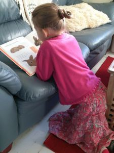 Princess snatching some reading time before swimming this morning.